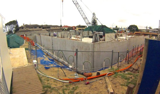 The new apartment blocks under construction at Orewa.  The basement floor must be virtually at mean high water level, with the ground floor barely three metres higher.
