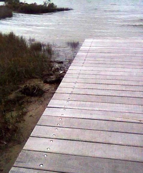 I took the accompanying photo as the tide was coming in at the end of the boardwalk.  High tide was at least 1/2 to 3/4hr away.