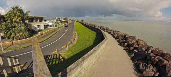 The top of the seawall looks about 2.5 metres above the road level.