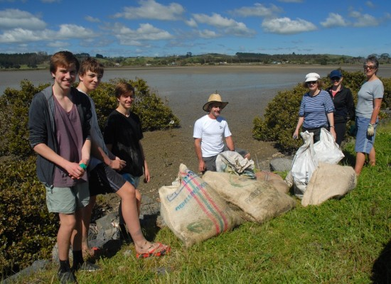 Our band of seven (plus the photographer) with our sacks of seedlings.